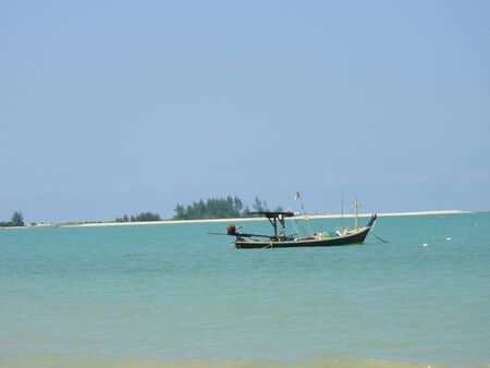Fishing boats on the sandy beach at Khao Lak