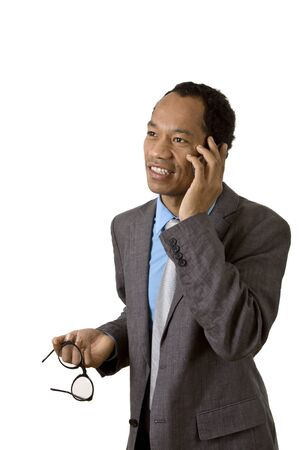 Attractive male in suit with mobile device and glasses
