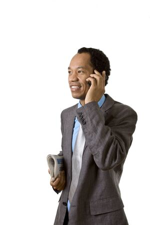 Business male talking on his mobile phone photo