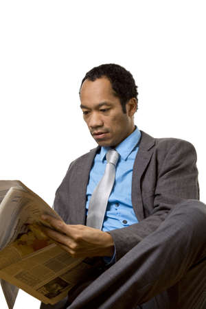 Business man reading the newspaper photo