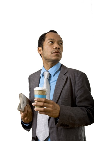 Business male having a break with coffee and paper photo