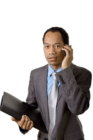 Afro american business man with mobile phone and briefcase photo
