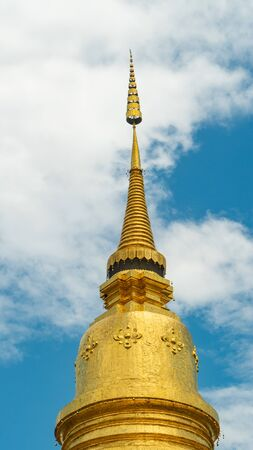Golden pagoda and cloud sky