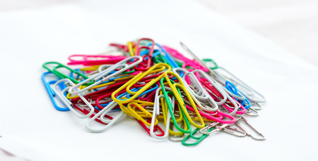 Colorful paper clip on white background. Stationary office.
