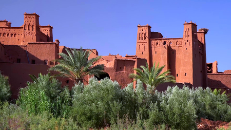 Ait Ben Haddou (or Ait Benhaddou) is a fortified city along the former caravan route between the Sahara and Marrakech in Morocco.