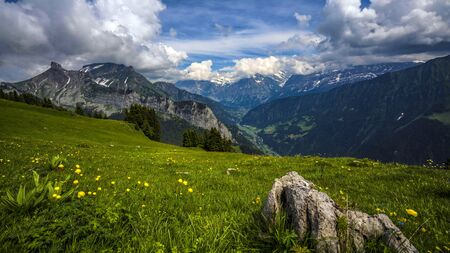 Panoramic view of idyllic mountain and landscape scenery in Switzerland.