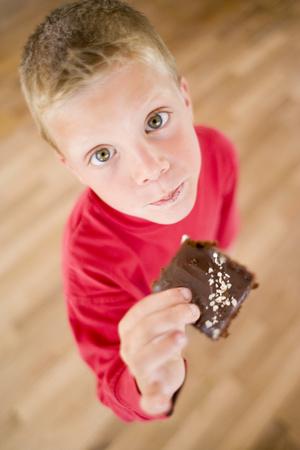 Boy eating chocolate cake