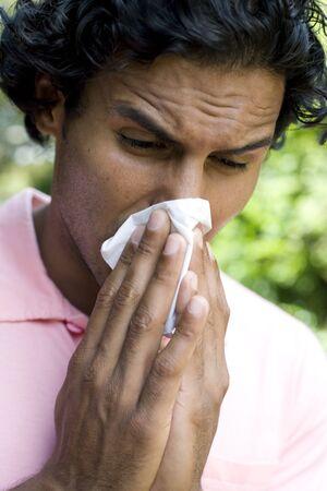 Man sneezing LANG_EVOIMAGES