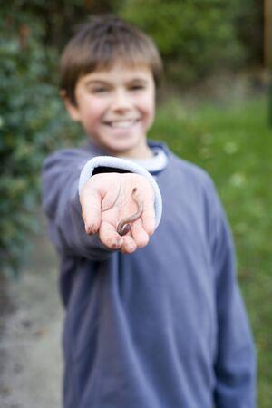 Boy holding an earthworm