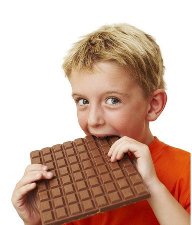 oversized: Boy eating chocolate LANG_EVOIMAGES