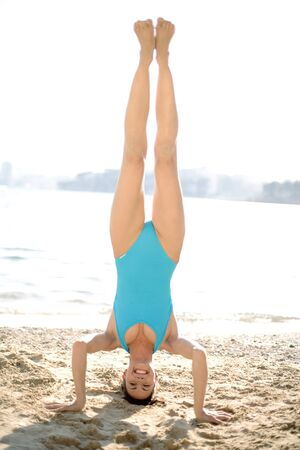headstand: Woman doing a headstand