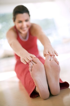 keep in touch: Woman touching her toes