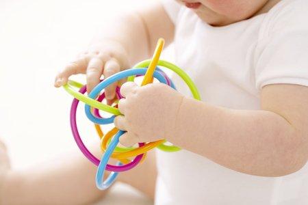teething: Baby boy playing LANG_EVOIMAGES