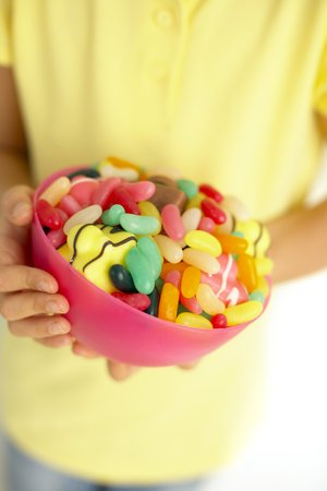 pre teen boy: Bowl of sweets