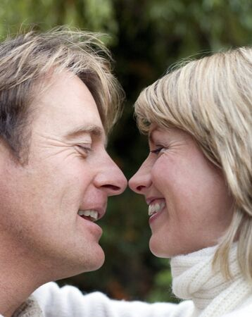 interacts: Smiling couple embracing LANG_EVOIMAGES