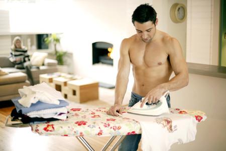 domesticity: Man ironing