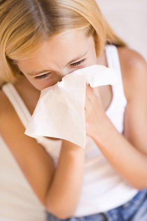 hayfever: Girl blowing her nose