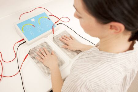 Iontophoresis.This is a treatment for excess sweating of the hands