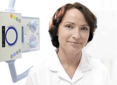 Radiographer next to an X-ray machine
