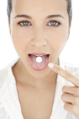 Woman taking medication LANG_EVOIMAGES