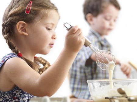 Young children baking