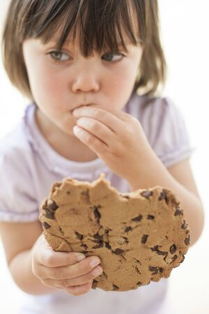 Toddler eating a cookie