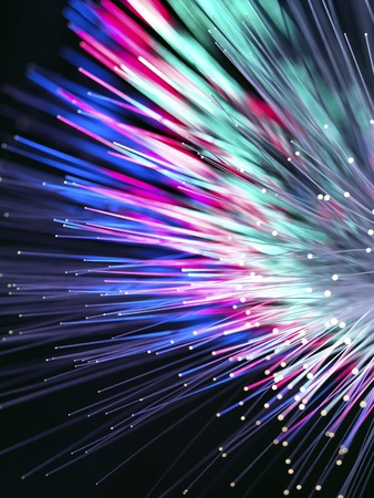 Optical fibres emitting light.Optical fibres are used in telecommunications to transmit data at high speed LANG_EVOIMAGES