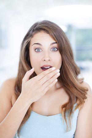 MODEL RELEASED. Surprised woman