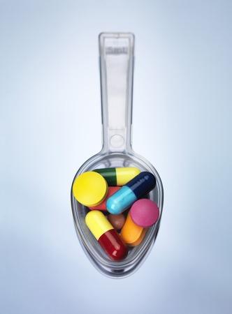 sobredosis: Cucharada de medicina