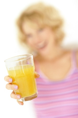 MODEL RELEASED. Woman with orange juice