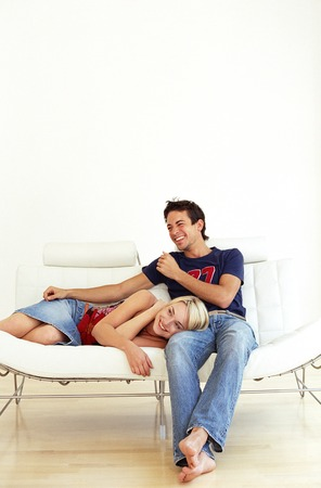 couple on couch: MODEL RELEASED. Happy couple