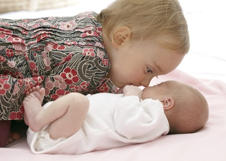 MODEL RELEASED. One year old girl with her two week old baby sister