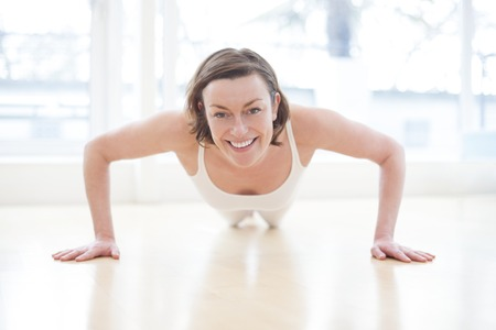 Woman doing press ups, front view