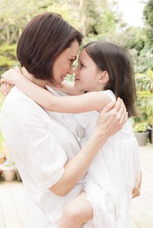 PROPERTY RELEASED. MODEL RELEASED. Mother and daughter hugging, portrait LANG_EVOIMAGES