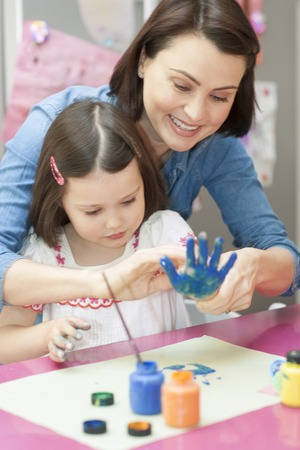PROPERTY RELEASED. MODEL RELEASED. Mother and daughter doing hand painting
