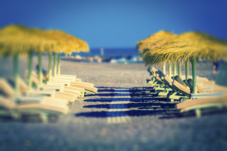 Sunloungers and parasols on a beach LANG_EVOIMAGES
