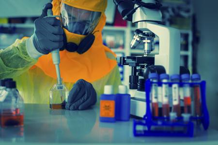 Scientist in hazmat suit