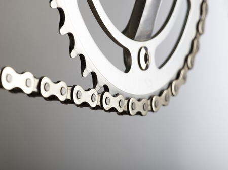things that go together: Bicycle chain and crank, close up