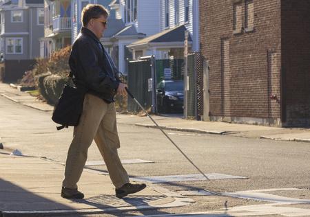 congenital: Blind man crossing the street LANG_EVOIMAGES