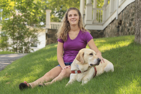 impaired: Visually impaired woman with her dog LANG_EVOIMAGES