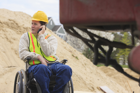 Construction supervisor in wheelchair LANG_EVOIMAGES