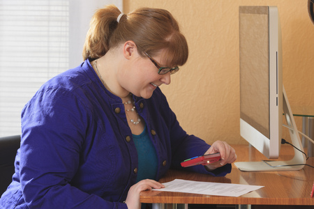 visually: Visually impaired woman reading
