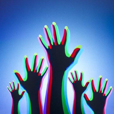 Coloured lights shining onto peoples hands and mixing LANG_EVOIMAGES