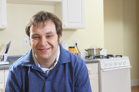 asperger: Man with Asperger syndrome at home
