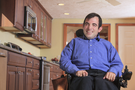 cerebral palsy: Disabled man in his kitchen LANG_EVOIMAGES