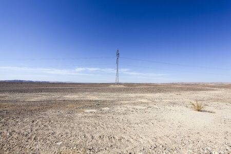 Electricity pylon in desert LANG_EVOIMAGES