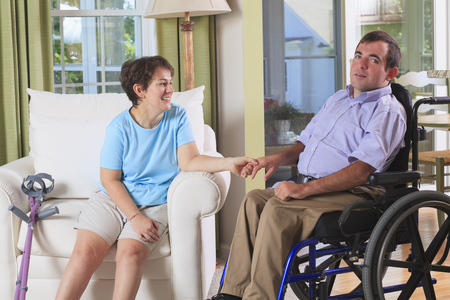 cerebral palsy: Couple with Cerebral Palsy holding hands
