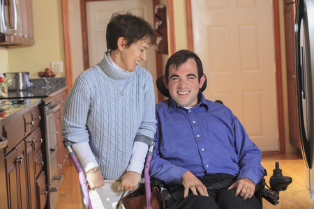 cerebral palsy: Disabled couple in accessible kitchen