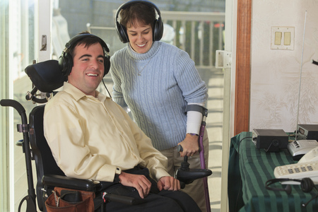 cerebral palsy: Disabled couple using headphones