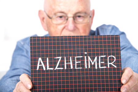 Man holding board with Alzheimer on it
